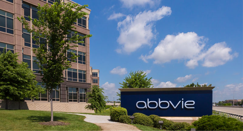 AbbVie building and sign in front of a blue sky.